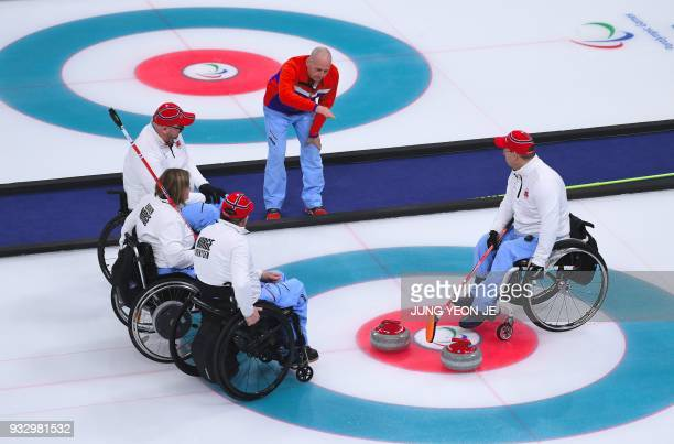 Norway's coach Peter Dahlman speaks to his team in the Wheelchair Curling gold medal game between China and Norway at the Gangneung Curling Centre...
