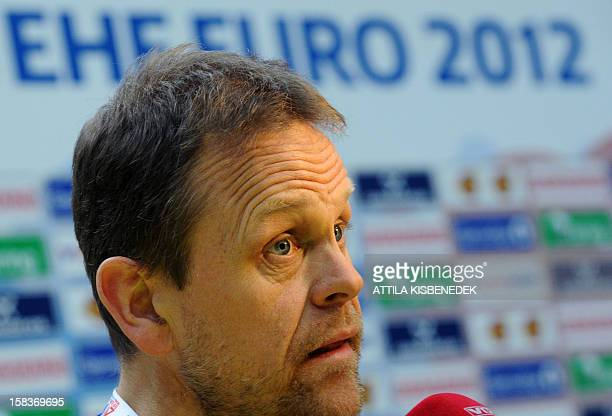 Norway's coach Thorir Hergeirsson answers journalists' questions on the media day of the 2012 EHF European Women's Handball Championship on December...