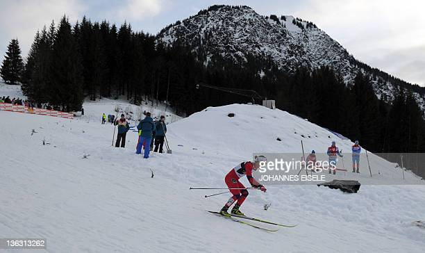 Norway's cross country skier Marit Bjoergen competes to win the women's Tour de Ski skiathlon 5 km Classic 5 km Freestyle event on January 1 2012 in...