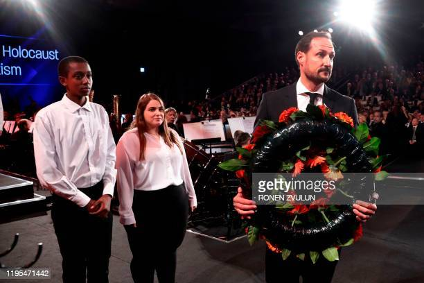 Norway's Crown Prince Haakon lays a wreath during the Fifth World Holocaust Forum at the Yad Vashem Holocaust memorial museum in Jerusalem on January...