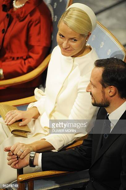 Norway's Crown Princess MetteMarit and Crown Prince Haakon sit during the Nobel Peace Prize award ceremony at City Hall in Oslo on December 10 2009...