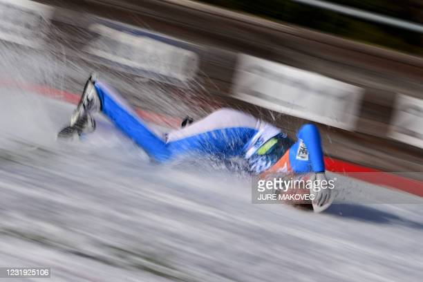 Norways Daniel Andre Tande falls to the ground during the FIS Ski Jumping World Cup Flying Hill Individual competition in Planica on March 25, 2021.