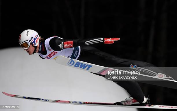 Norways Daniel-Andre Tande soars through the air during the Large Hill Team event of the FIS Ski Jumping World Cup in Wisla, Poland on November 18,...