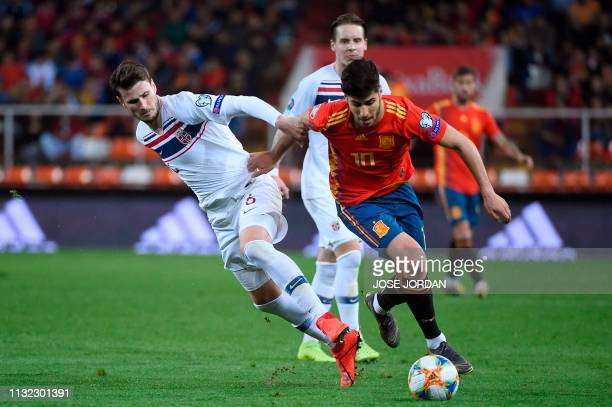 Norway's defender Havard Nordtveit challenges Spain's midfielder Marco Asensio during the Euro 2020 group F qualifying football match between Spain...