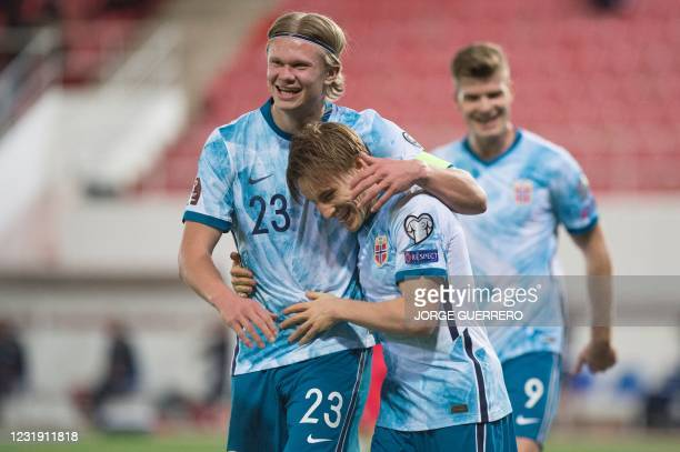 Norway's defender Jonas Svensson celebrates his goal with forward Erling Braut Haaland during the FIFA World Cup Qatar 2022 qualification football...