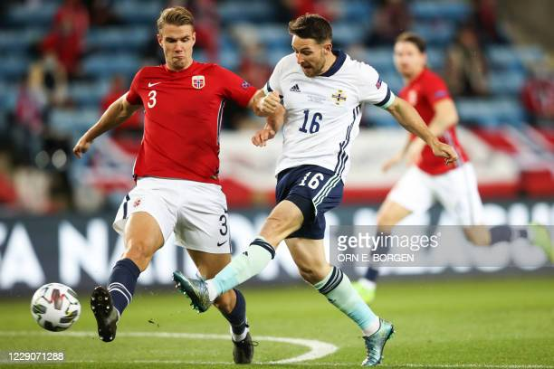 Norway's defender Kristoffer Vassbakk Ajer and Northern Ireland's forward Conor Washington vie for the ball during the UEFA Nations League football...