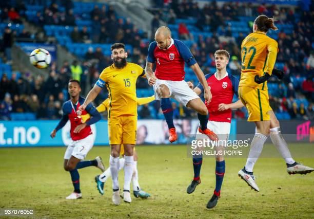 Norway's defender Tore Reginiussen scores as Australia's midfielder Jackson Irvine and Australia's midfielder Mile Jedinak look on during the...