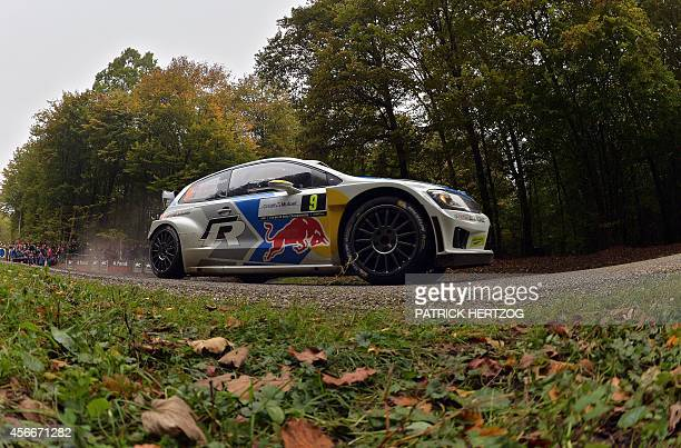 Norway's driver Andreas Mikkelsen and codriver Ola Floene steer their Volkswagen Polo R WRC during the Rally of FranceAlsace the 11th event of the...