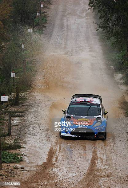 Norway's driver Mads Ostberg and Sweden's codriver Jonas Andersson compete in their Adapta WRT during the first stage of the 48th Rally of Catalonia...