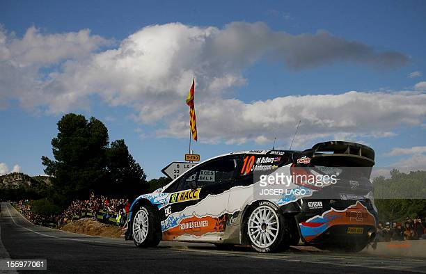 Norway's driver Mads Ostberg and Sweden's codriver Jonas Andersson drive their Ford Fiesta RS WRC during the second stage of the 48th Rally of...