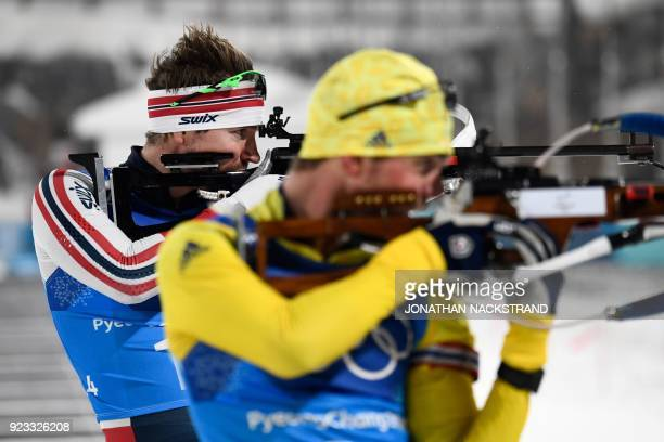 TOPSHOT Norway's Emil Hegle Svendsen and Germany's Arnd Peiffer compete at the shooting range in the men's 4x75km biathlon event during the...