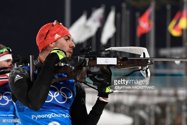 Norway's Emil Hegle Svendsen and Germany's Simon Schempp compete at the shooting range in the mixed relay biathlon event during the Pyeongchang 2018...