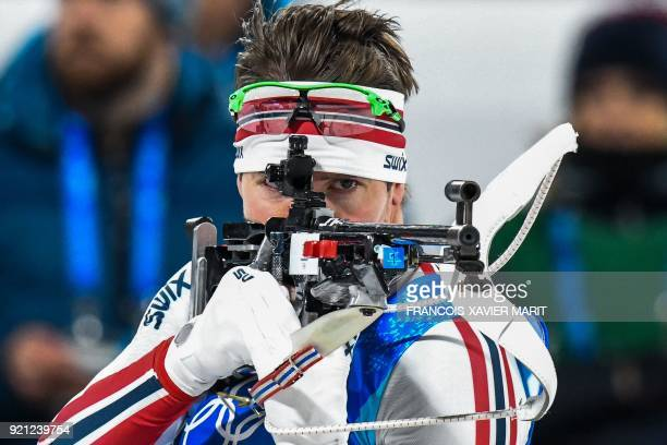 TOPSHOT Norway's Emil Hegle Svendsen competes at the shooting range in the mixed relay biathlon event during the Pyeongchang 2018 Winter Olympic...