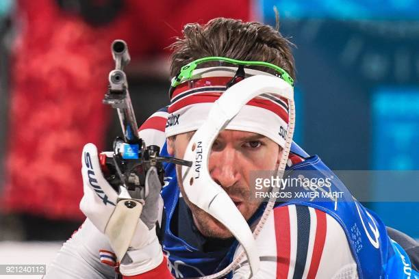 Norway's Emil Hegle Svendsen competes at the shooting range in the mixed relay biathlon event during the Pyeongchang 2018 Winter Olympic Games on...