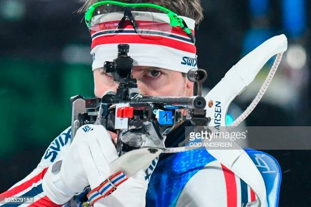 TOPSHOT Norway's Emil Hegle Svendsen competes at the shooting range in the men's 4x75km biathlon event during the Pyeongchang 2018 Winter Olympic...