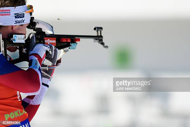 Norway's Emil Hegle Svendsen competes at the shooting range of the Men's 125 km pursuit race of the IBU Biathlon World Cup in Pokljuka on December 10...