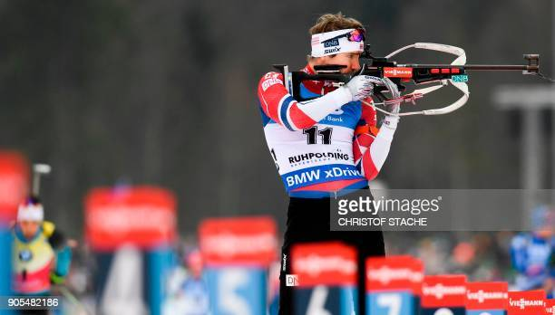 Norway's Emil Hegle Svendsen shoots during the warmup shooting prior the men's 15 kilometer mass start competition at the Biathlon World Cup on...