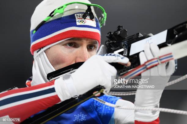 Norway's Emil Hegle Svendsen warms up in the mixed relay biathlon event during the Pyeongchang 2018 Winter Olympic Games on February 20 in...