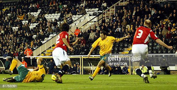Norway's Erik Hagen moves in as Australia's Josip Skoko shoots and scores during an International Friendly at Craven Cottage in London 16 November...