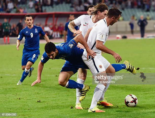Norway's Even Hovland and Stefan Strandberg foul Azerbaijan's Ramil Sheydaev during the WC 2018 football qualification match between Azerbaijan and...