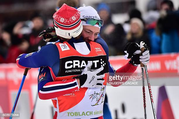 Norway's Finn Haagen Krogh hugs his compatriot Martin Johnsrud Sundby after they compete in the Men's 10 km individual free competition of the Tour...