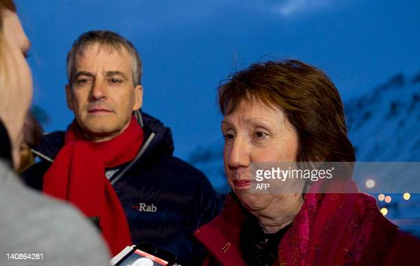 Norway's Foreign Affairs minister Jonas Gahr Stoere and EU foreign policy chief Catherine Ashton talk to journalists as she arrives at Longyearbyen...