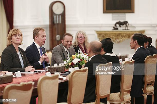 Norway's Foreign Minister Borge Brende and Indonesian President Joko Widodo are seen during their meeting in the Presidential Palace in Jakarta...
