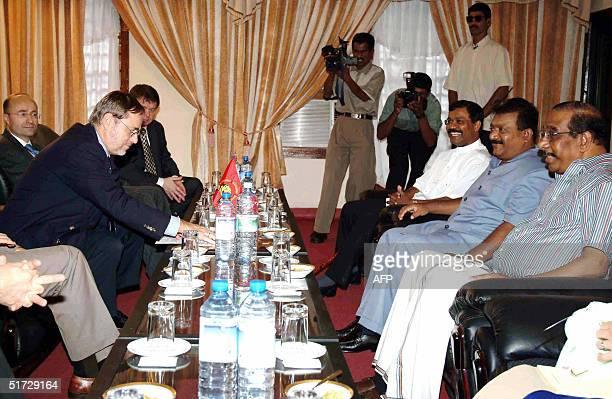 Norway's Foreign Minister Jan Petersen in talks with Tamil Tiger guerrilla leader Velupillai Prabhakaran 11 November 2004 in the rebelheld Sri Lankan...