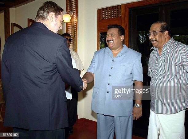 Norway's Foreign Minister Jan Petersen shakes hands with the top Tamil Tiger guerrilla leader Velupillai Prabhakaran 11 November 2004 in the...