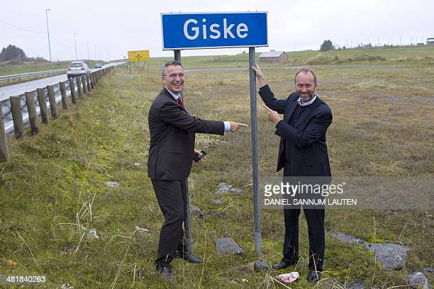 Norway's former Prime Minister Jens Stoltenberg and Norwy's former Trade and Industry Minister Trond Giske are seen in front of a road sign named...