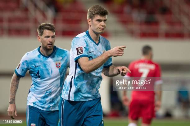 Norway's forward Alexander Soerloth celebrates his goal with defender Stefan Strandberg during the FIFA World Cup Qatar 2022 qualification football...
