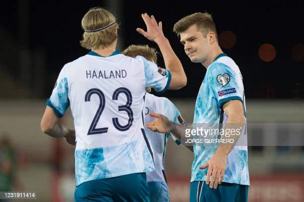 Norway's forward Alexander Soerloth celebrates his goal with forward Erling Braut Haaland during the FIFA World Cup Qatar 2022 qualification football...