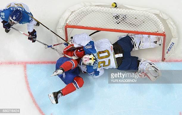 Norway's forward Andreas Martinsen collides with Kazakhstan's goalie Vitali Kolesnik during the group A preliminary round game Kazakhstan vs Norway...
