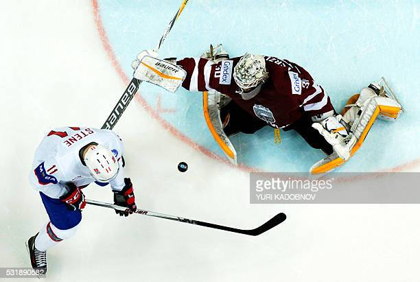 TOPSHOT Norway's forward Andreas Stene attacks Latvia's goalie Elvis Merzlikins during the group A preliminary round game Latvia vs Norway at the...