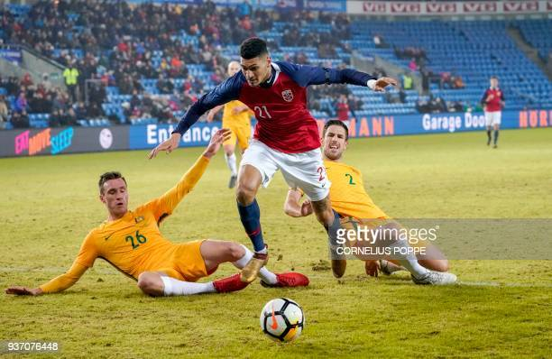 Norway's forward Bjorn Johnsen vies for the ball with Australia's Aleksandar Susnjar and Milos Degenek during the international friendly football...