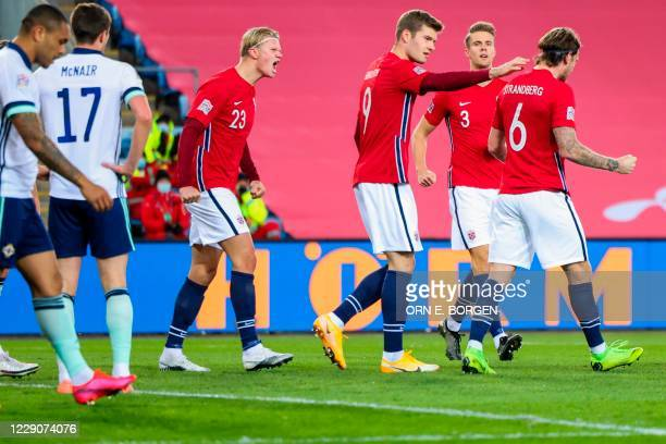 Norway's forward Erling Braut Haaland and his teammates celebrate after an own goal by Northern Ireland during the UEFA Nations League football match...