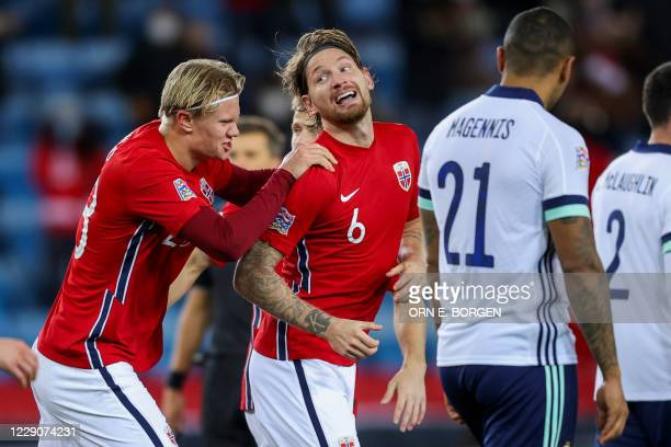 Norway's forward Erling Braut Haaland and Stefan Strandberg celebrate after an own goal by Northern Ireland during the UEFA Nations League football...