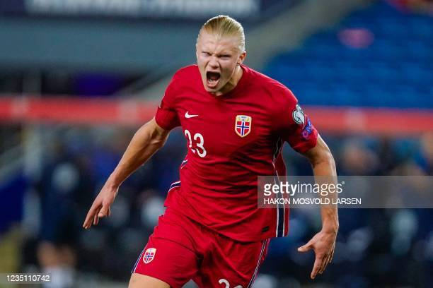 Norway's forward Erling Braut Haaland celebrates scoring the 5-1 goal during the FIFA World Cup Qatar 2022 qualification Group G football match...