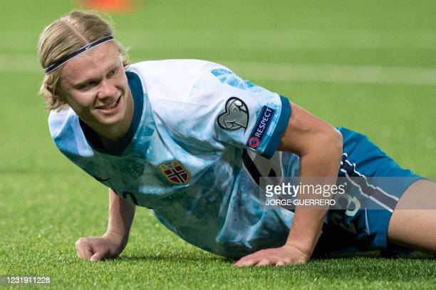 Norway's forward Erling Braut Haaland lays on the field during the FIFA World Cup Qatar 2022 qualification football match between Gibraltar and...