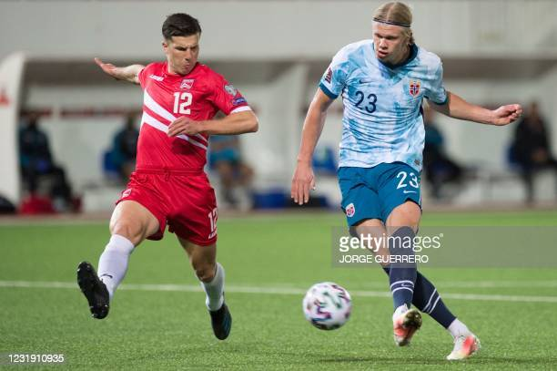Norway's forward Erling Braut Haaland vies with Gibraltar's midfielder Jayce Olivero during the FIFA World Cup Qatar 2022 qualification football...