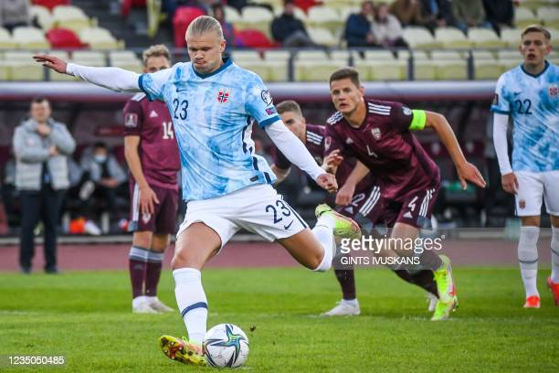 Norway's forward Erling Braut Haland kicks the ball to score the 0-1 goal during the FIFA World Cup Qatar 2022 qualification Group G football match...