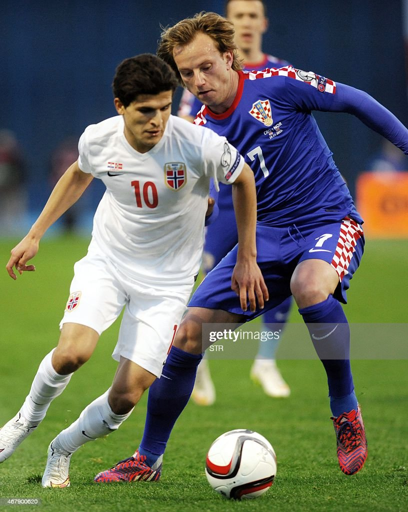 Norway's forward Tarik Elyounoussi (L) vies with Croatia's midfielder Ivan Rakitic during the Euro 2016 qualifying football match between Croatia and Norway on March 28, 2015 at the Maksimir stadium in Zagreb.