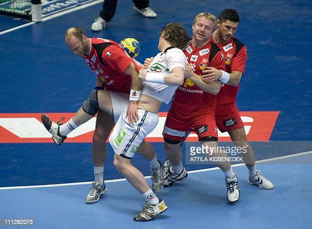 Norway's Frank Loke is stopped by Iceland's Olafur Indridi Stefansson Ingimundur Ingimundarsson and Alexander Petersson during the 22nd Men's...