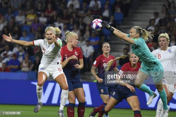 TOPSHOT Norway's goalkeeper Ingrid Hjelmseth makes a save in front of England's defender Steph Houghton during the France 2019 Women's World Cup...