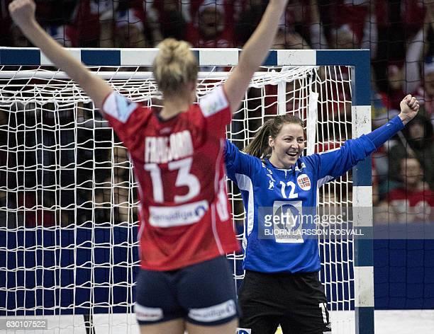 Norway's goalkeeper Silje Solberg and Marit Malm Frafjord celebrate after wining the woman's European Championship handball semifinal between France...