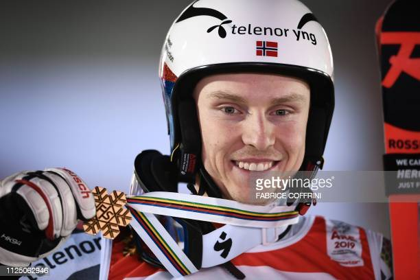 Norway's Gold medalist Henrik Kristoffersen celebrates after the men's Giant slalom event at the 2019 FIS Alpine Ski World Championships at the...