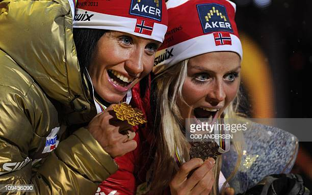 Norway's gold medalist Marit Bjoergen and Norway's bronze winner Therese Johaug pose with their medals at a ceremony after the 15km cross country...