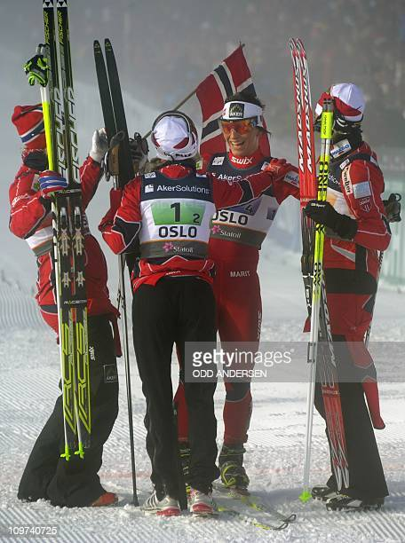 Norway's gold medalists from left Vibeke W Skofterud Therse Johaug Marit Bjoergen and Kristin Stoermer Staira celebrate after winning the women's 4X5...