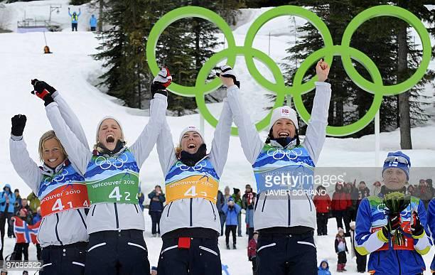 Norway's gold medalists Vibeke W Skofterud Norway'sTherese Johaug Norway's Kristin Stoemer Steira and Norway's Marit Bjoergen celebrate on the podium...