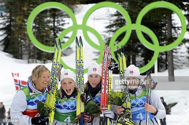 Norway's gold medalists Vibeke W Skofterud Therese Johaug Kristin Stoemer Steira and Marit Bjoergen stand on the podium after the women's Cross...